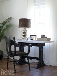 Her living-room desk is positioned to capture views of the old stone walls she loves.