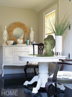Crystal knobs add sparkle to the breakfast area's lacquered sideboard. F