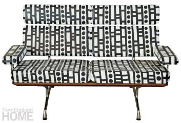 A Herman Miller sofa upholstered in Royal Hide leather in Super White, hand-painted by Selvaggia Armani.