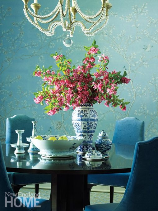 Hand-painted de Gournay wall panels make a dramatic backdrop for the dining room's Reagan Hayes chairs and a chandelier from Niermann Weeks.