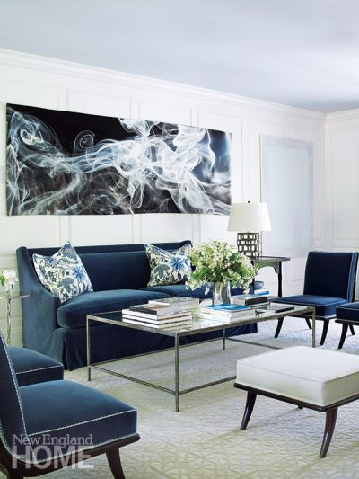 A spectacular tapestry by Pae White is displayed above the living room sofa. To the right of the sofa hangs the intriguing Proposal 15, a painting by Los Angeles artist Alex Olson.