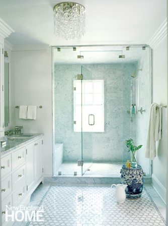 A fixture from Vaughan Designs lends glamour to the pristine master bath.