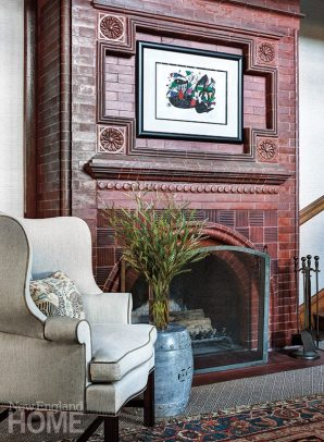 A work by Joan Miró hangs above the foyer's original brick fireplace.