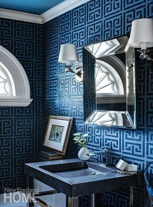 A Schumacher grasscloth with a Greek key design adds drama to the first-floor powder room.