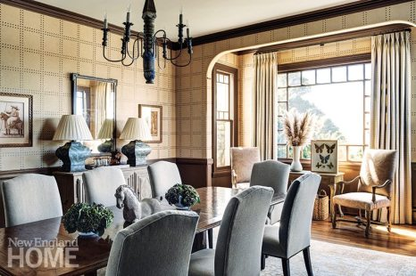 A wallcovering from the Phillip Jeffries Rivets collection clothes the dining room walls, where the palette of nature-inspired colors reflects the rocky coast outside.