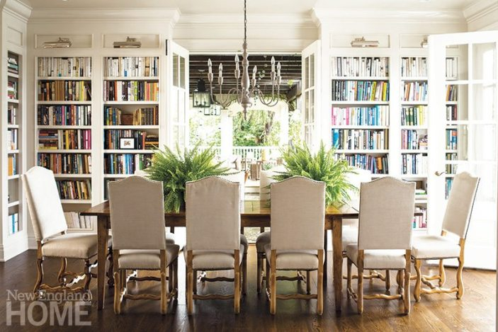 In the dining room/library, a French-style iron chandelier hangs above the antique walnut table that came from Green's parents' house in the South of France. Picture lights from Visual Comfort illuminate the bookshelves that wrap the room where her -children often do their homework.