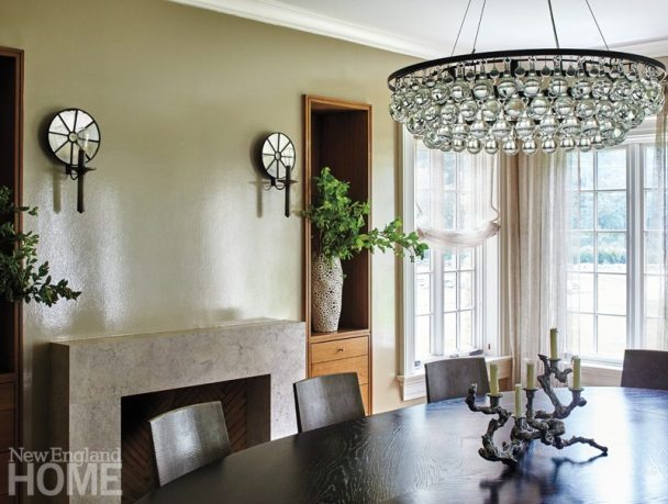 Mirrored Urban Electric sconces, a sparkly Arctic Pear chandelier by Ochre, and a shimmery Phillip Jeffries wallcovering give the dining room as much appeal by day as by night.