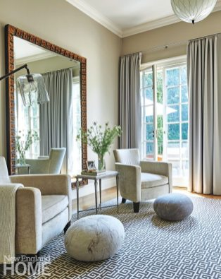 The ornately framed mirror hails from a previous residence. Paired with a graphic Stark carpet and Holly Hunt chairs, it adds an elegant note to the master suite's sitting area.