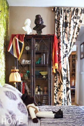 Another bedroom cabinet serves as a showcase for some of Bee's treasured collectibles.