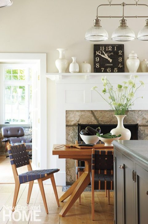 In the kitchen, everyone's favorite gathering spot, traditional millwork and more modern furniture make happy companions.