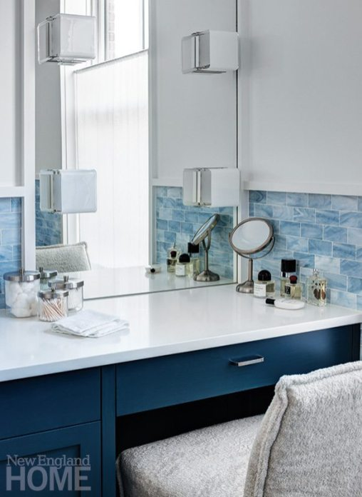 Colorful apartment for empty nesters bathroom lights