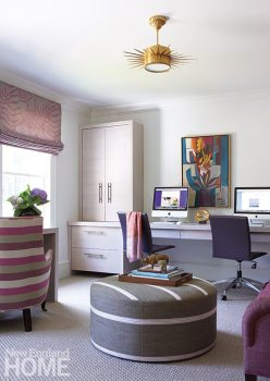 """Mother and daughter can work and relax together in the """"she cave"""" outfitted with custom rift-cut oak cabinets and lit by Visual Comfort's Soleil pendant."""