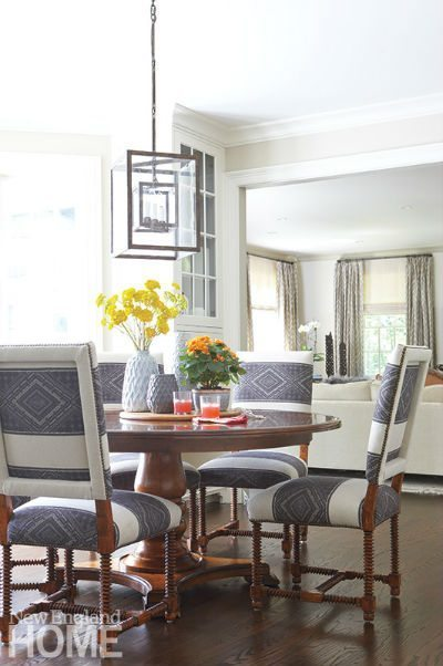 The breakfast room is dressed smartly with Guy Chaddock chairs and a Vaughan chandelier.