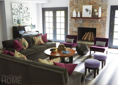 """The """"man cave"""" has a jazzy striped Missoni carpet and eye-catching purple velvet chairs."""