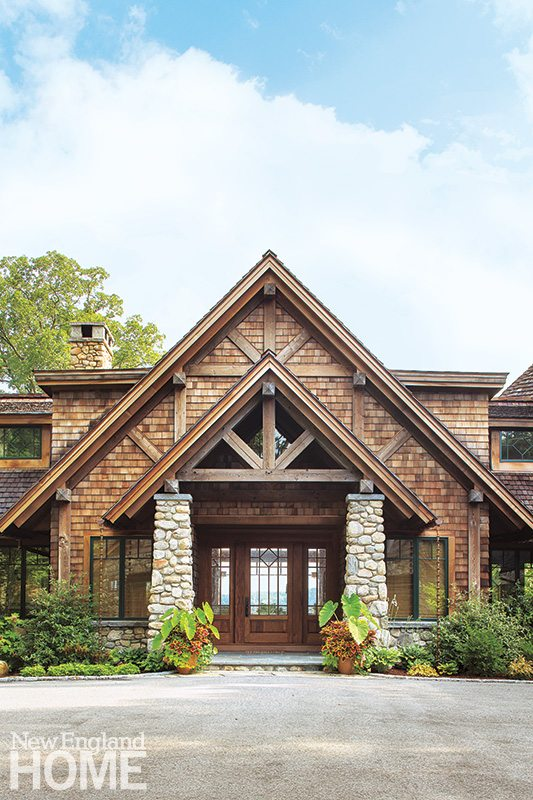 Local fieldstone forms the foundation, entry pillars, chimneys, and low stone walls that join Douglas fir timbers and cedar shingles to create a rustic, imposing exterior.