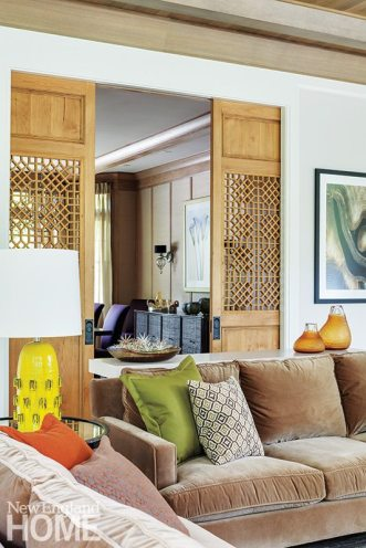 Wooden lattice screens close the dining room off from the family room.