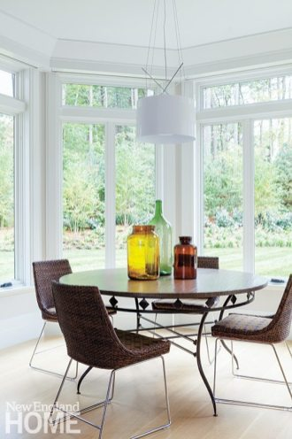 Tall windows offer backyard views from the five-sided breakfast nook.