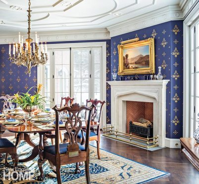 Local artist Josa Weatherwax stenciled and painted the dining room's celestial-blue walls.