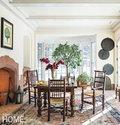 The conservatory acts as a breakfast room and an everyday entrance. Radiant heat beneath the brick floors keeps it cozy even on a snowy day.