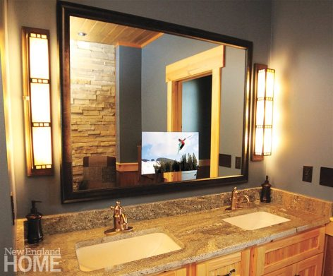 A mirror TV, like this one in a bathroom, vanishes when it's turned off.
