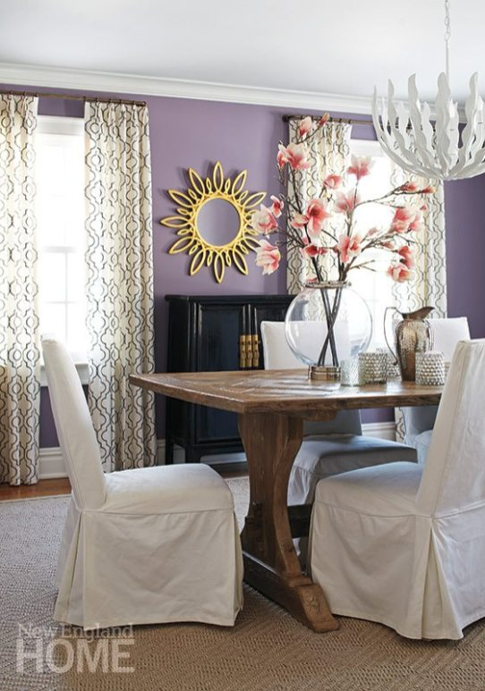 A rustic table from Parc Monceau looks right at home against the bold wall color choice the homeowner made.