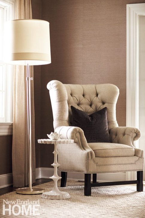 The spacious living room accommodates several seating areas, including this cozy corner.