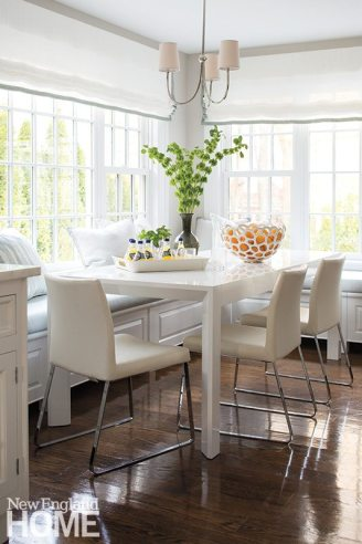 The breakfast area off the kitchen is a study in white and the palest of blues.
