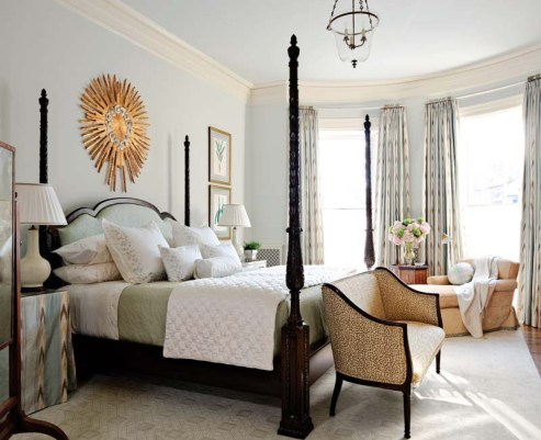 An antique sunburst and leopard settee offset the master bedroom's traditional tone.