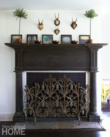 An antique mantel from the Salks' previous home provides a sense of history, and a fire screen from Pergola in New Preston adds sparkle.
