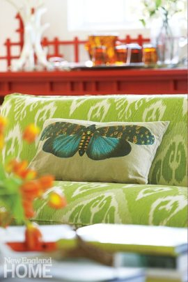 A pillow from Pier 1 enlivens an old settee from Mitchell Gold + Bob Williams that Susanna reupholstered in an ikat fabric from Ballard Designs.