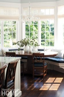 A breakfast area combines deep woods with the kitchen's ever-present white.