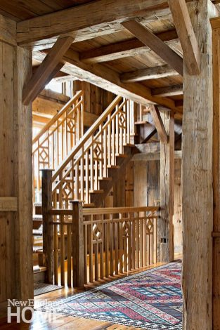 The spectacular staircase mixes verticals, horizontals, and diagonals with wood both rough-hewn and polished.