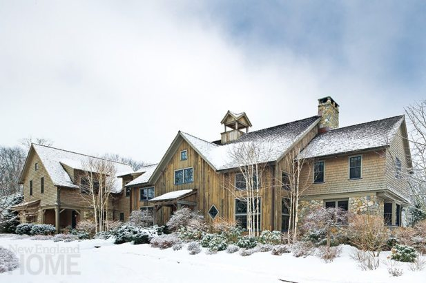 Looking perfectly comfortable in a wintry setting, this Redding home takes its design cues (and even some of its building materials) from nearby Connecticut barns.