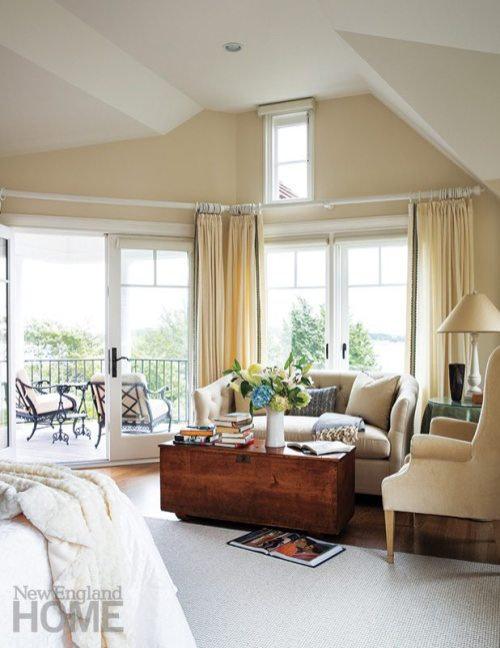 In the master suite, a sofa and wing chair provide inviting roosts, while an antique chest serves as a put-your-feet-up coffee table.