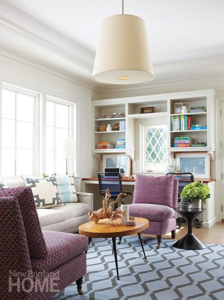 """Bold textiles and a contemporary coffee table from Jonathan Adler add energy to the """"teen room,"""" where the family's three children can do homework or hang out with friends."""