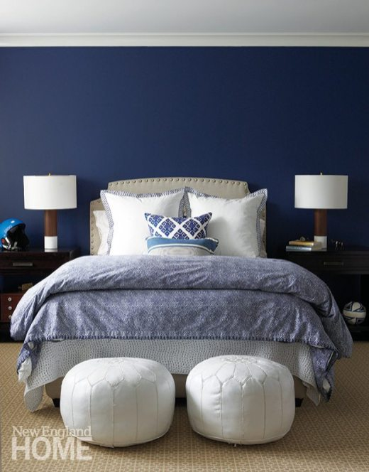 """Dark-blue walls and a mix of textiles create an upscale """"man cave"""" for the son."""
