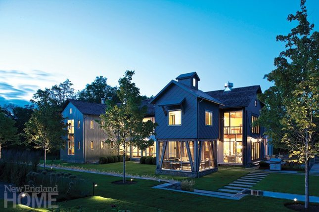 A modern farmhouse designed by Norwalk architect Bruce Beinfield has a system by Realm that controls the lighting, window shades, heating and air conditioning, and all the hom