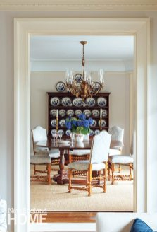 William and Mary-style chairs encircle the table in the dining room, where a collection of Blue Willow china purchased on eBay adds a colorful punch to the antique hutch.