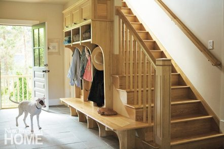 This mudroom, also by DeGan, is both charming and highly functional.