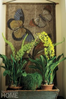Larger-than-life butterflies in the foyer are painted on antique sailcloth.
