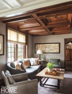 """""""We picked the antique rug before we even knew what we were going to do with the family room,"""" says Westcott. An antique map and leather chair also boost the room's cozy spirit."""