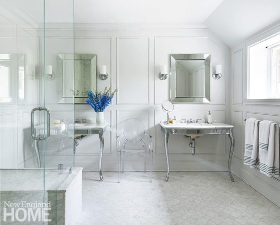 Natural light makes the master bath's pale floor and walls luminous.