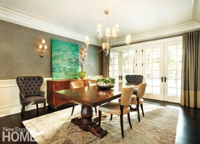 Simple draperies let the dining room's shimmery wallpaper take center stage.