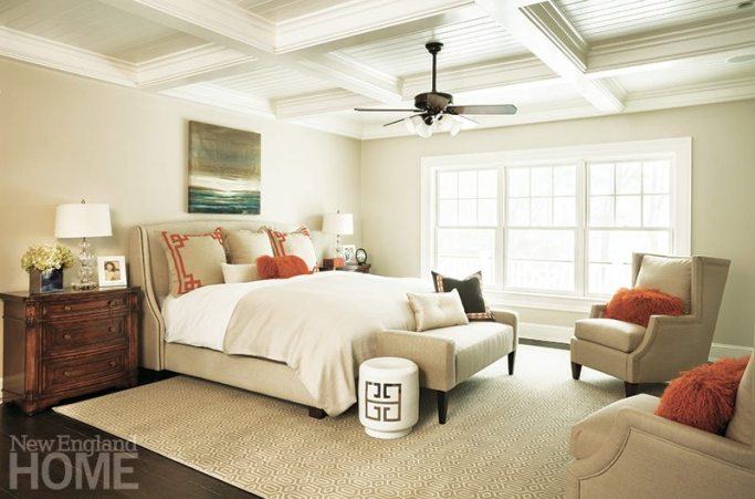 Variations on a Greek key design are found in the master bedroom rug, bedding pillows, and porcelain garden stool.