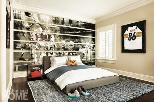 A photo of a key moment in a Pittsburgh Steelers game was reproduced in large format and installed as a backdrop for the bed in a son's room.