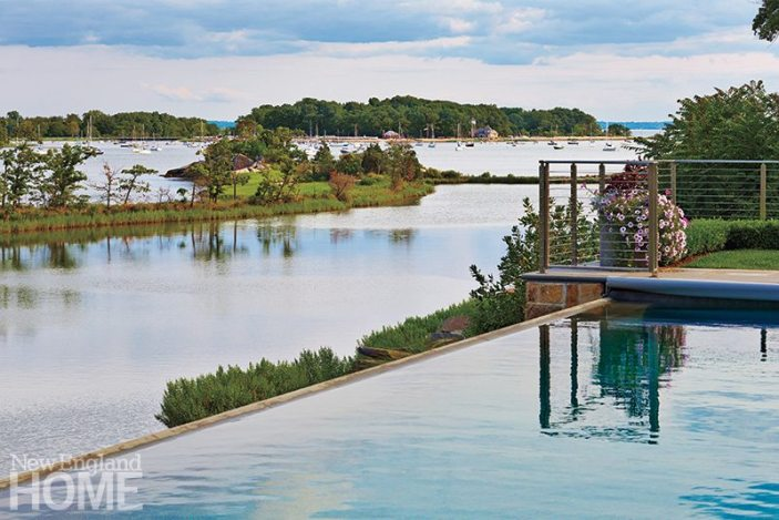 Water streams to the edge of the pool, blending in with the natural scenery beyond.