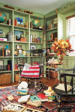 The owners chose a historic green paint color to marry the rooms and provide continuity.