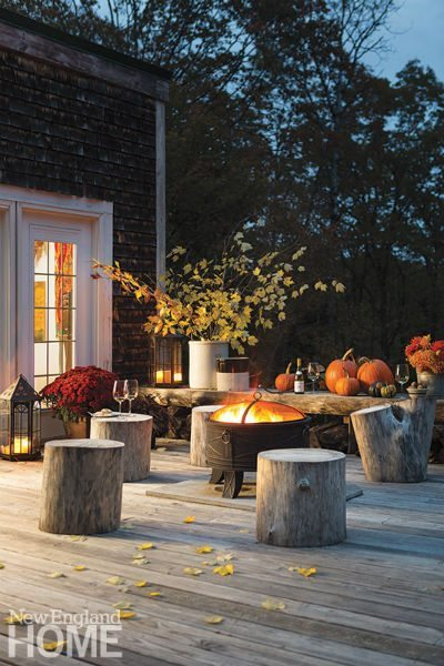 Tree stumps often serve as seating when the owners host a gathering on the deck.