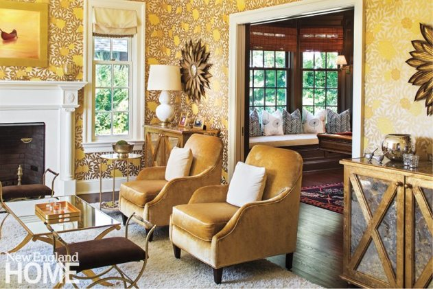 The living room glows with her choice of a rich palette of golds and yellows highlighted by the geometric-floral wallpaper by Osborne & Little.