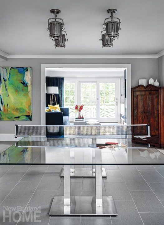 A custom-made glass Ping Pong table doubles as the family dining table.